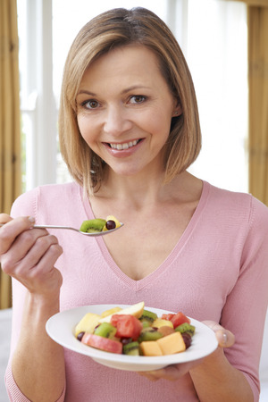 unrecognisable people: Close Up Of Woman Holding Bowl Of Fresh Fruit Stock Photo