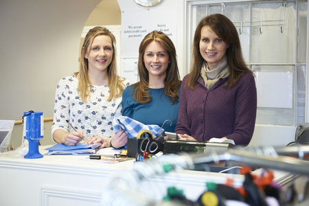 voluntary: Three Female Voluntary Workers In Charity Shop