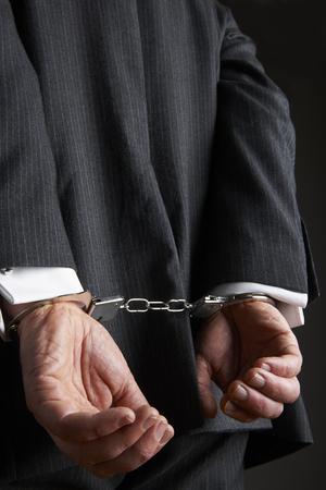 cuffed: Businessman With Hands Cuffed Behind Back