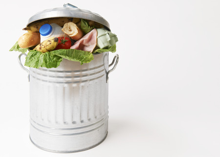 garbage: Fresh Food In Garbage Can To Illustrate Waste Stock Photo