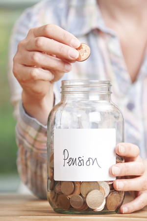 labelled: Woman Dropping Coins Into Jar Labelled Pension