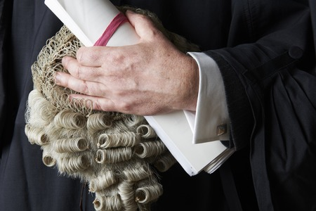 barrister: Close Up Of Barrister Holding Wig And Brief Stock Photo