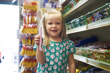 shopping binge: Happy Child At Candy Counter Of Supermarket