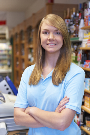sales assistant: Portrait Of Sales Assistant At Supermarket Checkout