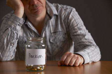 labelled: Depressed Man Looking At Empty Jar Labelled Pension