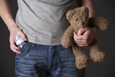 cuddly toy: Father Holding Feeding Bottle And Teddy Bear