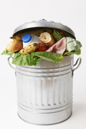 garbage bin: Fresh Food In Garbage Can To Illustrate Waste Stock Photo
