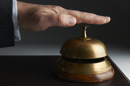 service bell: Business Ringing Service Bell On Stock Photo