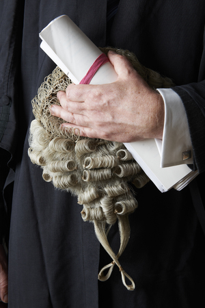barrister: Close Up Of Barrister Holding Brief And Wig