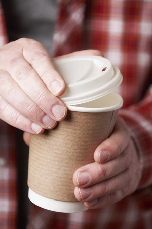 unrecognisable person: Man Holding Cup Of Takeaway Coffee
