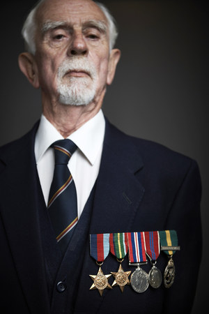 honour: Studio Portrait Of Senior man Wearing Medals