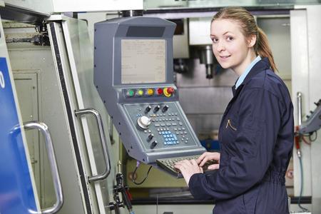 computerized: Female Apprentice Engineer Operating Computerized Cutting Machin