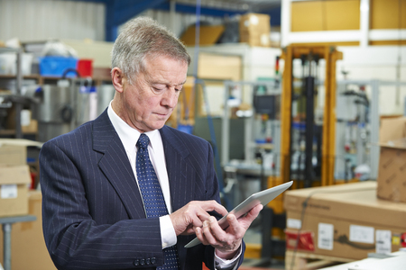 engineering clipboard: Factory Owner Using Digital Tablet