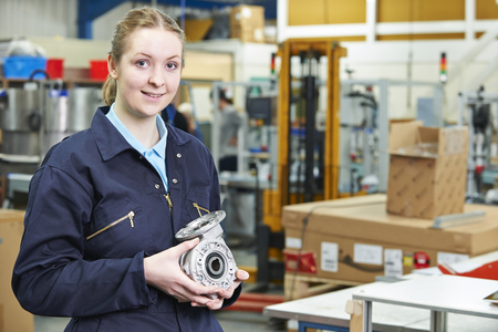 19 year old: Portrait Of Female Apprentice Holding Component
