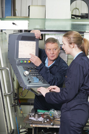 19 year old: Apprentice And Engineer Using Computer Controlled Cutting Machin