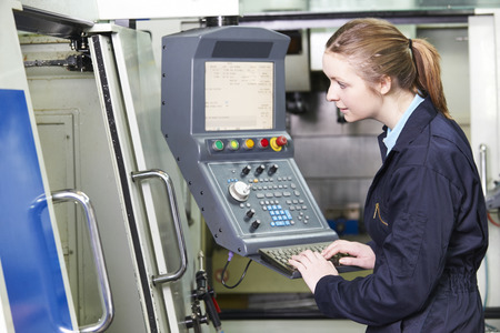 machinist: Female Engineer Operating Computerized Cutting Machine