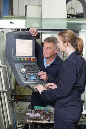 computerized: Engineer And Apprentice Using Computerized Cutting Machine
