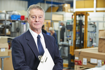 engineering clipboard: Portrait Of Manager On Factory Floor