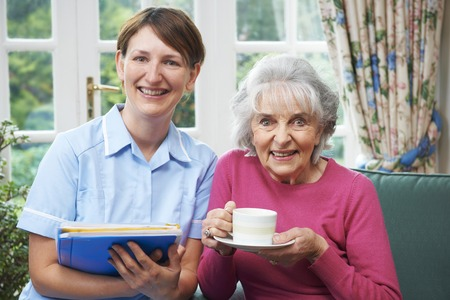 carer: Senior Woman With Carer At Home Stock Photo