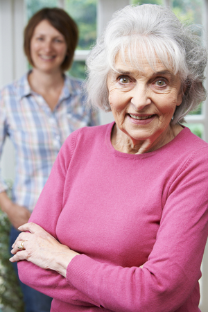 senior adult woman: Senior Woman With Adult Daughter At Home