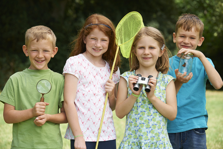 exploring: Group Of Childrfen Exploring Nature Together Stock Photo