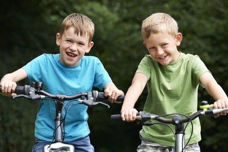 year old: Two Boys Riding Bikes Together