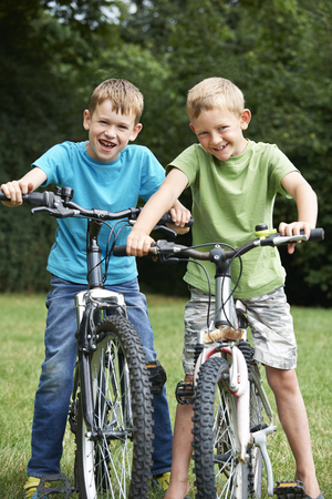 two boys: Two Boys Riding Bikes Together