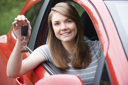 female driver: Young Female Driver In Car Holding Keys