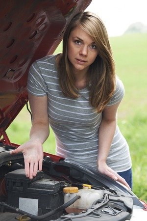 engine bonnet: Frustrated Female Motorist With Broken Down Car Stock Photo