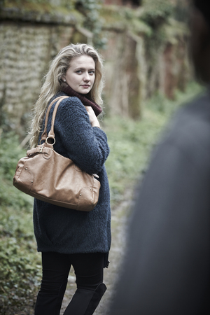 boy 18 year old: Young Woman Feeling Threatened As She Walks Home Stock Photo
