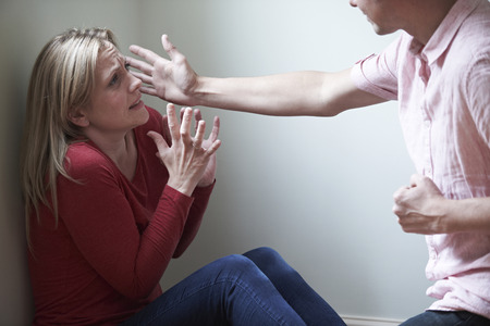 aggression: Man Being Physically Abusive Towards Female Partner Stock Photo