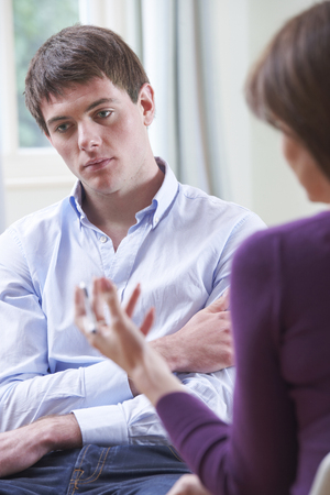 depressed man: Depressed Young Man Talking To Counsellor