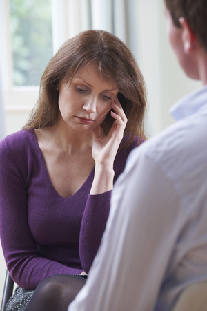 counsellor: Depressed Mature Woman Talking To Counsellor