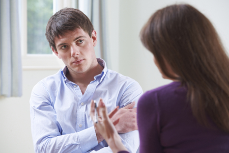 depression man: Depressed Young Man Talking To Counsellor