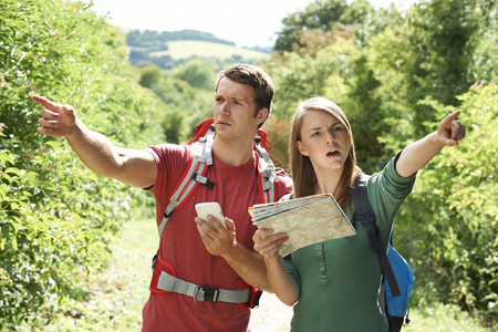 arguement: Couple Disagreeing About Best Way To Navigate On Hike Stock Photo