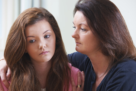 teenage problems: Mother Comforting Teenage Daughter Stock Photo