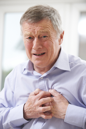 heart pain: Senior Man Suffering Heart Attack At Home