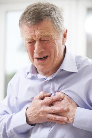 Senior Man Suffering Heart Attack At Home