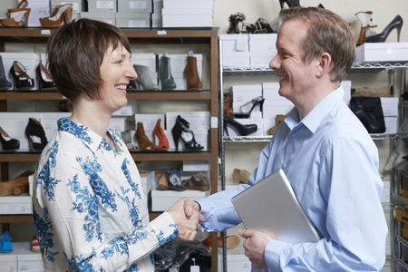 retail store: Businessman Shaking Hands With Shoe Store Retailer