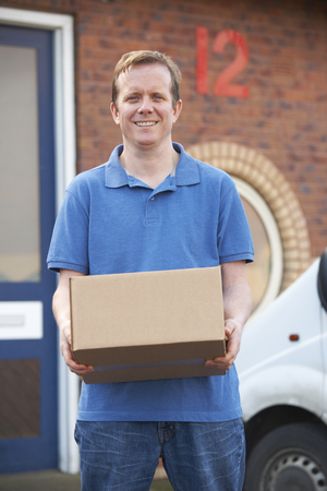 courier: Courier Delivering Package To Office Stock Photo