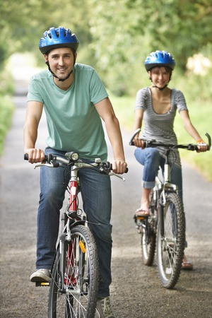 country road: Young Couple Cycling Along Country Road Stock Photo