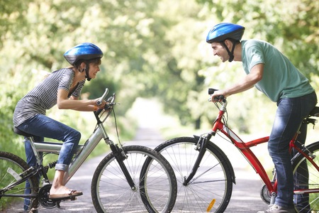 road cycling: Young Couple Cycling On Country Road