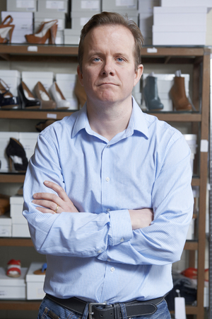 tienda de zapatos: Propietario de sexo masculino de zapato tienda
