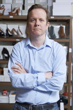 shoe store: Propietario de sexo masculino de zapato tienda