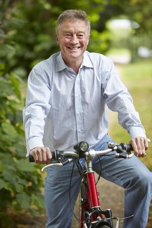 cycle ride: Senior Man Enjoying Cycle Ride