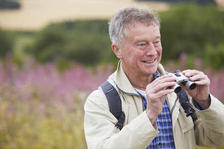 Senior Man On Walk With Binoculars