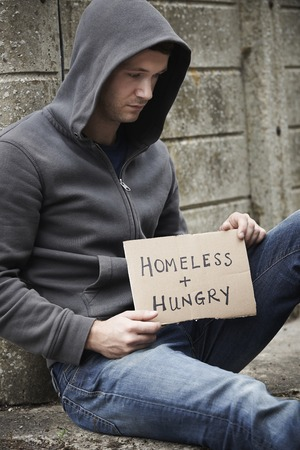 destitute: Homeless Young Man Begging On The Street