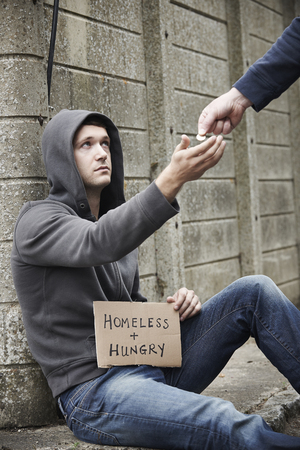 beggar: Man Giving Money To Beggar On Street Stock Photo