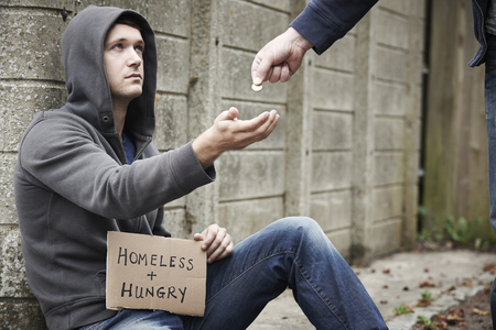 hungry: Man Giving Money To Beggar On Street Stock Photo