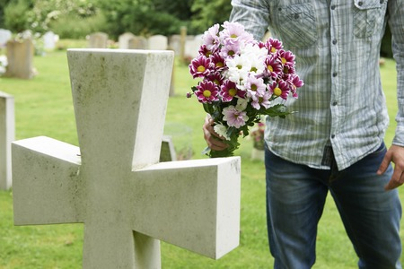 graves: Man Laying Flowers On Grave